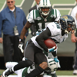 Nov 15, 2009; East Rutherford, NJ, USA; Jacksonville Jaguars cornerback Brian Witherspoon (38) runs through tackle attempts on a punt return during first half NFL action between the New York Jets and Jacksonville Jaguars at Giants Stadium.