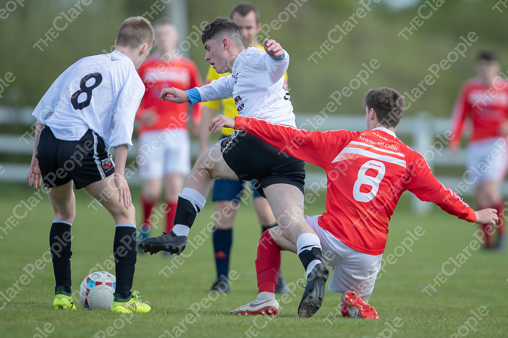 Manus Celtic's Daragh Healy is tackled by Newmarket Celtic's Callum Hussey