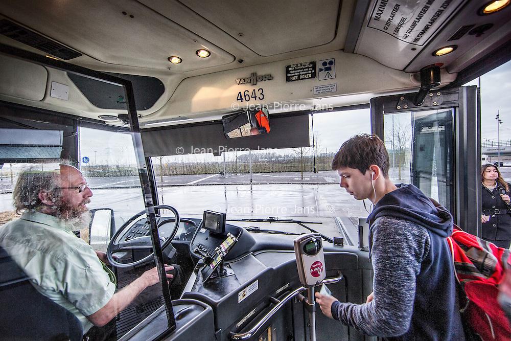 Nederland, Almere, 8 april 2016.<br /> Buschauffeur Lucas Lowesteijn aan het werk.<br /> Verhaal over steeds meer agressie en geweld richting buschauffeurs<br /> <br /> <br /> <br /> Foto: Jean-Pierre Jans