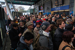 Finnsbury Park, London, December 27th 2014. All trains in and out of King's Cross, one of the busiest stations in London, have been cancelled thanks to engineering work on the East Coast mainline overrunning. A limited sevice is running from Finnsbury Park station which has become heavily congested, with British Transport Police called in to assist with crowd control. PICTURED: Hundreds of passengers anxiously wait outside Finnsbury Park station as staff limit admissions to avoid overcrowding on the platforms.
