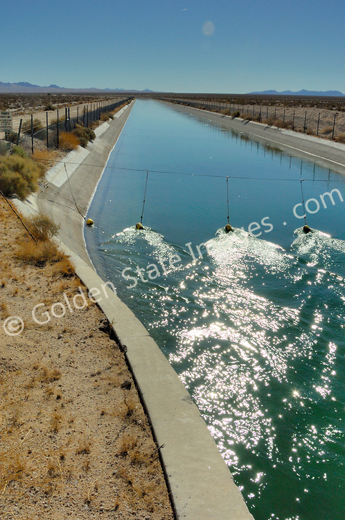 Completed in 1941 the Colorado River Aqueduct carries water 242 miles from Lake Havasu on the Colorado River to Lake Matthews in western Riverside County.    <br /> <br /> Recognized as one of the seven wonders of American engineering by the American Society of Civil Engineers.    <br /> <br /> Its capacity is 1.3 million acre-feet per year.
