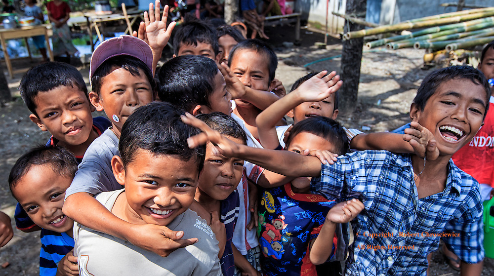 Smile: Boys laughing, pushing, waving and generally having too much fun; all the while posing for a photograph during the full moon celebration of Maulid (the Prophet Muhammad's birthday) Anyar Lombok Indonesia.