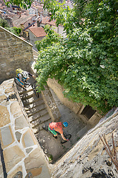 Bikers riding bicycle while climbing down stairs