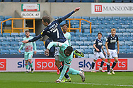 Millwall midfielder Jed Wallace(7)  and Swansea City Defender Marc Guehi(5) battles for possession during the EFL Sky Bet Championship match between Millwall and Swansea City at The Den, London, England on 10 April 2021.