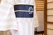 JAPAN, TOKYO -  Kururi Kimono , Sriped pink and white Kimono , Black obi with purple flowers - from the shop Kururi in Omotesando - 06-2014