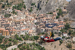 """Castelmezzano/Basilicata/Italy - Aug 02, 2009 - Fly of the Angel. The two towns of Pietrapertosa and Castelmezzano in the Italian Dolomites decided they wanted to attract more tourists.<br /> One suggested it was a shame they could not fly to the other village - and the idea of the """"Flight of the Eagles"""" device - a mile-long metal cable suspended between two peaks - was born. Those willing to take up the challenge hang from a harness connected to the steel rope and then jump off from a special platform to travel across the valley which is 500m below.<br /> Riders can reach speeds of up to 90mph."""