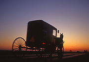 Amish horse and buggy silhouette on road, sunset, Lancaster, PA