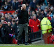Josep Guardiola manager of Manchester City has plenty to think about as he leaves for the half time talk  during the Premier League match at Old Trafford, Manchester. Picture date: 8th March 2020. Picture credit should read: Darren Staples/Sportimage