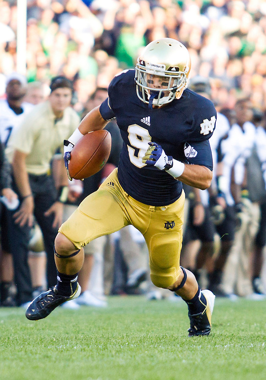 September 08, 2012:  Notre Dame wide receiver Robby Toma (9) runs for yardage during NCAA Football game action between the Notre Dame Fighting Irish and the Purdue Boilermakers at Notre Dame Stadium in South Bend, Indiana.  Notre Dame defeated Purdue 20-17.