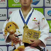 Gold medalist Aaron Wolf of Japan celebrates his victory during an awards ceremony after the Men -100 kg category at the Judo Grand Prix Budapest 2018 international judo tournament held in Budapest, Hungary on Aug. 12, 2018. ATTILA VOLGYI