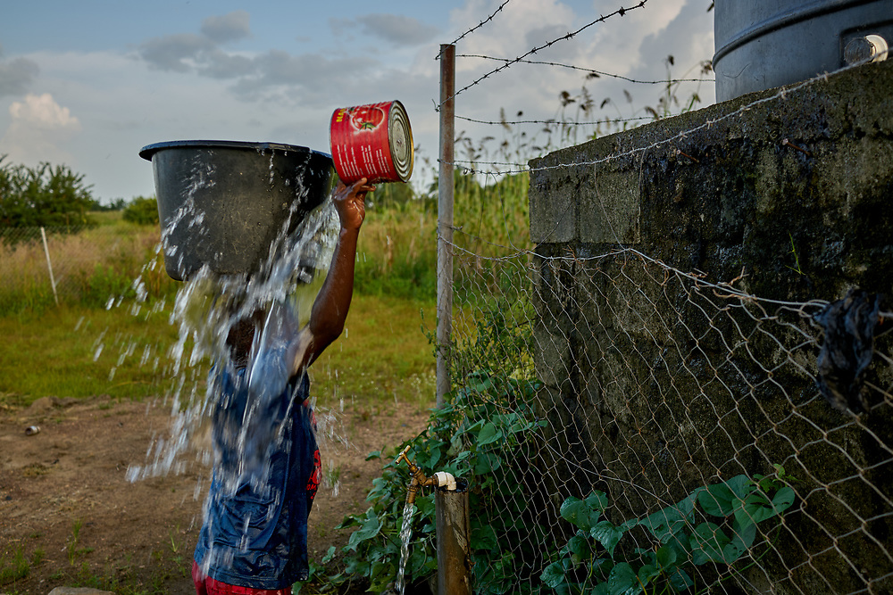 25/10/2019 / Kpatua / Ghana:<br /> Peter fetches water from the solar powered pump in Kpatua. <br /> <br /> Oxfam built a solar powered pump in Kpatua to help over families become more resilient during dry seasons. Apart from community members coming to the pump twice a day, all year round, during the dry season, women use the water from the pump to farm vegetables for sale.