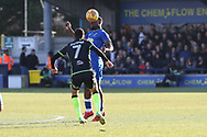 AFC Wimbledon defender Deji Oshilaja (4) winning a header during the EFL Sky Bet League 1 match between AFC Wimbledon and Bristol Rovers at the Cherry Red Records Stadium, Kingston, England on 17 February 2018. Picture by Matthew Redman.