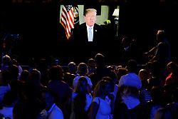 Guests watch U.S. President Donald Trump's address of the South Lawn of the White House before a fireworks display in Washington, D.C., U.S., on Wednesday, July 4, 2018. Trump's campaign won the technical knockout of a lawsuit filed by two Democratic National Committee donors and a DNC staffer who accused it of colluding with Russian to publish compromising information about the Clinton campaign on WikiLeaks that included details about their lives. Photographer: Yuri Gripas/Bloomberg