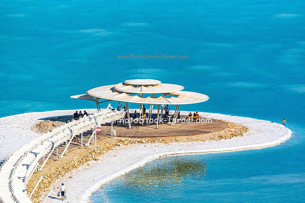 Tourists float in the heavy waters of the Dead Sea, Israel
