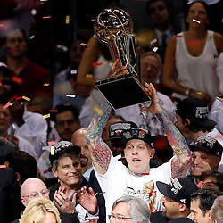 Jun 20, 2013; Miami, FL, USA; Miami Heat power forward Chris Andersen raises the Larry O'Brien Championship trophy following game seven in the 2013 NBA Finals at American Airlines Arena. Miami defeated the San Antonio Spurs 95-88 to win the NBA Championship. Mandatory Credit: Derick E. Hingle-USA TODAY Sports