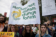 Supporters and protesters listen to speeches and hold up their banners and placards at the Rise For Climate Change event held outside Tate Modern in London, England, United Kingdom on September 8th 2018. Tens of thousands of people joined over 830 actions in 91 countries under the banner of Rise for Climate to demonstrate the urgency of the climate crisis. Communities around the world shined a spotlight on the increasing impacts they are experiencing and demanded local action to keep fossil fuels in the ground. There were hundreds of creative events and actions that challenged fossil fuels and called for a swift and just transition to 100% renewable energy for all. Event organizers emphasized community-led solutions, starting in places most impacted by pollution and climate change. Photographed for 350.org