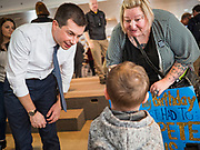28 JANUARY 2020 - OSCEOLA, IOWA: PETE BUTTIGIEG talks to a boy who came to Buttigieg's rally with his grandmother (right) at a campaign event at the Clarke County Fairgrounds in Osceola, about 50 miles south of Des Moines. Buttigieg talked to a crowd of about 130 people in Osceola. Buttigieg, the former mayor of South Bend, Indiana, is running to be the Democratic nominee for President in the 2020 election. Iowa traditionally holds the first presidential selection event of the 2020 election cycle. The Iowa Caucuses are on Feb. 3, 2020.     PHOTO BY JACK KURTZ