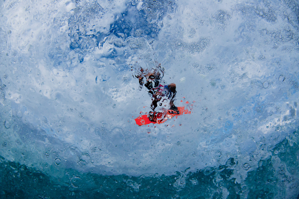 Slightly abstracted image of a kiteboarder flying high in The Bahamas.