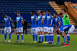 Barrow players during a minute silence - Mandatory by-line: Ryan Crockett/JMP - 27/10/2020 - FOOTBALL - One Call Stadium - Mansfield, England - Mansfield Town v Barrow - Sky Bet League Two