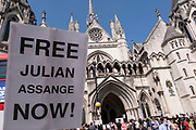 Scene outside the Royal Courts of Justice as protesters gather holding placards in support of Julian Assange during his latest High Court hearing on 11th August 2021 in London, United Kingdom. Following Judge Vanessa Baraitser's earlier ruling that he was a 'suicide risk' if extradited to the US, she denied his extradition. Today, the court ruled that the United States can resume it's appeal to extradite Assange, against this decision. Assange has been held in prison since his conviction in 2019 following approximately 7 years claiming political asylum in the Ecuadorian Embassy in London.