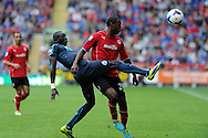 Newcastle's Papiss Cisse is challenged by Cardiff's Kevin Theophile-Catherine. Barclays Premier League match, Cardiff city v Newcastle Utd  at the Cardiff city stadium in Cardiff, South Wales on Saturday 5th Oct 2013. pic by Andrew Orchard, Andrew Orchard sports photography,