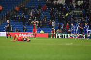 AFC Bournemouth players are left dejected at the final whistle after they draw 1-1 and lose valuable points. Skybet football league championship, Cardiff city v AFC Bournemouth at the Cardiff city stadium in Cardiff, South Wales on Tuesday 17th March 2015.<br /> pic by Andrew Orchard, Andrew Orchard sports photography.