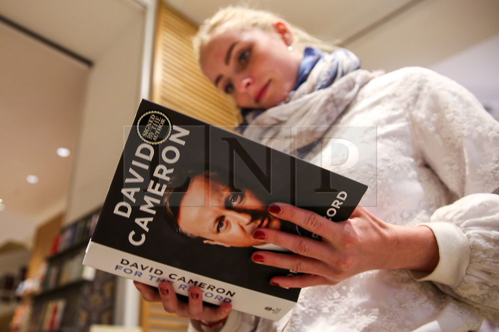 """© Licensed to London News Pictures. 19/09/2019. London, UK. A tourist from Germany views a copy of """"For The Record"""" - the autobiography of Britain's former Prime Minister David Cameron on display in Waterstones book store in central London. Since his resignation in 2016, David Cameron has remained all-but silent on his time in office. In For the Record he finally breaks that silence. Photo credit: Dinendra Haria/LNP"""