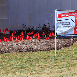 Millersville, PA / USA - February 22, 2016: Silence, in and of itself, cannot be interpreted as Consent banner, along with red flags, at the Millersville University, in Lancaster County, PA