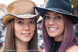 Olivia (L) and Alexa Jacobs outside the Scott Jacobs Gallery where they work on Main Street in Deadwood during the annual Sturgis Black Hills Motorcycle Rally. Deadwood, SD, USA. Monday August 7, 2017.  Photography ©2017 Michael Lichter.