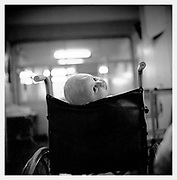 A child in a wheelchair after an operation. Branch Oncology Children's Hospital. Warsaw, Poland 1987.