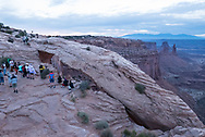Photographers gather for sunrise at Mesa Arch, Utah. Picture by Andrew Tobin.