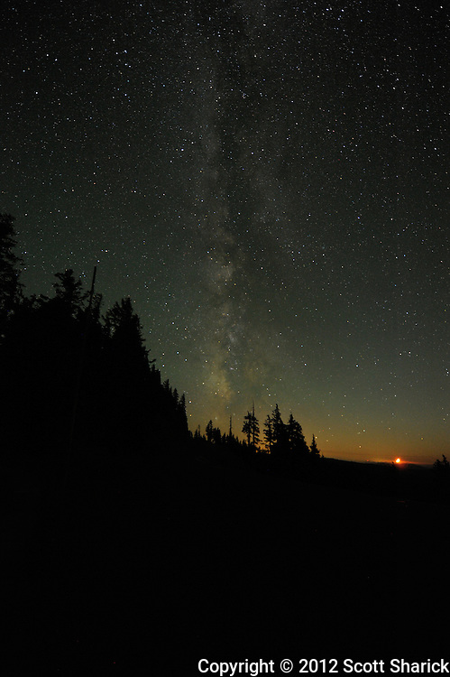 The Milky Way hovers over the setting moon at Crater Lake National Park. The moon really was blood red when it set probably due to distant wildfires.