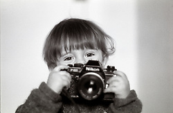 London, February 2004. Gabriele is exploring photography. Well,,,, let's say he likes very mutch to play with his dad's cameras cameras. However, he takes pictures already! ..Ps He his holding a film camera Nikon F301