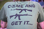 Pro monument protester in New Orleans wearing a pro-gun shirt.