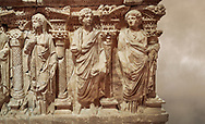"""Roman relief sculpted sarcophagus of Domitias Julianus and Domita Philiska, 2nd century AD, Perge. Antalya Archaeology Museum, Turkey.<br /> <br /> it is from the group of tombs classified as. """"Columned Sarcophagi of Asia Minor"""". <br /> The lid of the sarcophagus is sculpted into the form of a """"Kline"""" style Roman couch on which lie Julianus &  Philiska. This type of Sarcophagus is also known as a Sydemara Type of Tomb.. Against a warm art background. .<br /> <br /> If you prefer to buy from our ALAMY STOCK LIBRARY page at https://www.alamy.com/portfolio/paul-williams-funkystock/greco-roman-sculptures.html . Type -    Antalya    - into LOWER SEARCH WITHIN GALLERY box - Refine search by adding a subject, place, background colour, etc.<br /> <br /> Visit our ROMAN WORLD PHOTO COLLECTIONS for more photos to download or buy as wall art prints https://funkystock.photoshelter.com/gallery-collection/The-Romans-Art-Artefacts-Antiquities-Historic-Sites-Pictures-Images/C0000r2uLJJo9_s0"""