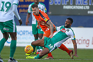Plymouth Argyle midfielder Joel Grant (16) tacklesLuton Town forward James Collins (19) during the EFL Sky Bet League 1 match between Luton Town and Plymouth Argyle at Kenilworth Road, Luton, England on 17 November 2018.