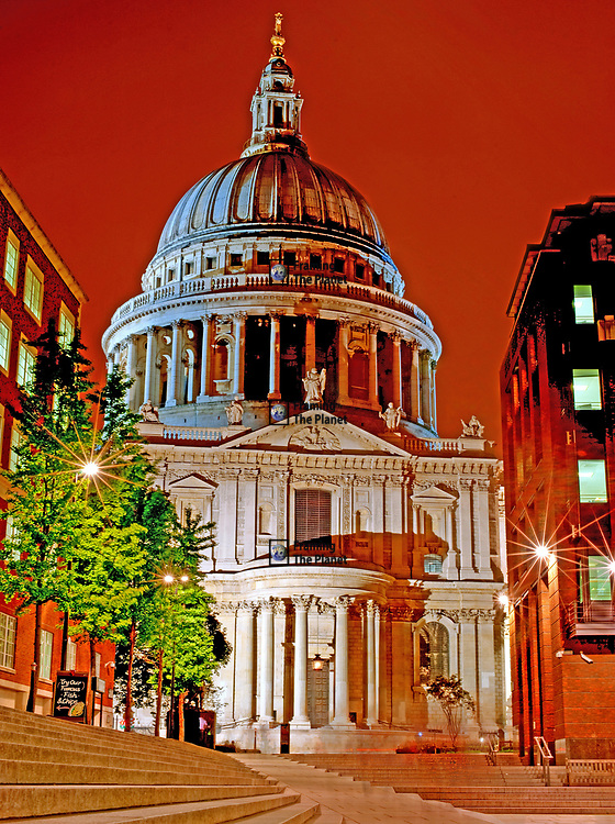 This is a truly beautiful image of the world famous dome that sits at the top of St Paul's Cathedral in the heart of London in the City of Westminster. This image was taken during the night time hours and has some really strong colours, the sky is an amazing orange highlighting the details of this historic building. <br /> <br /> I took this photograph recently on a trip to London, I had been in the City near the Bank of England and had been taking photos around that area and decided I would walk back to Waterloo. On passing the Cathedral there was no way I could resist turning around and getting an image of this amazing site.