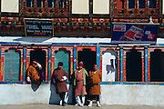 Bhutanese men at general stores shop which sells Pepsi and  rents out home videos in Paro, Bhutan
