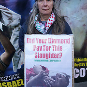 Protest On 8th December 2017, the eve of the Kimberley Process Plenary Meeting in Brisbane, Inminds human rights group will hold a vigil outside the Australian High Commission in London to highlight the failure of the Kimberley Process in preventing the trade in blood diamonds that fund human rights violations around the world, in particular in Palestine. Australia chairs the Kimberley Process this year, and is hosting the Kimberley Process Plenary Meeting outside Australian High Commission, London, UK.