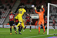 Football - 2020 / 2021 Sky Bet Championship - AFC Bournemouth vs. Wycombe Wanderers - The Vitality Stadium<br /> <br /> Adebayo Akinfenwa of Wycombe has a point blank header well saved by Bournemouth's Asmir Begovic during the Championship match at the Vitality Stadium (Dean Court) Bournemouth <br /> <br /> COLORSPORT/SHAUN BOGGUST