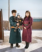 A family dressed up for Tsagaan Sar, the Mongolian Lunar New Year.<br /> <br /> Travels in the Gobi desert region.