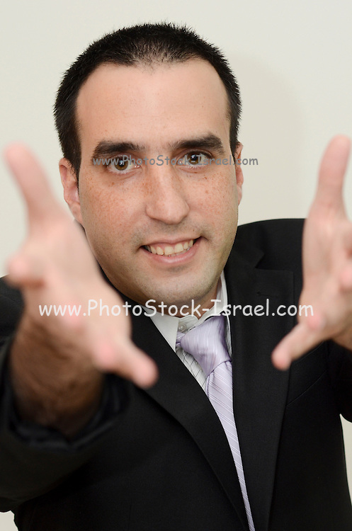 Young business man in suit and tie with outstretched hands