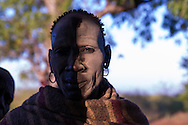 Man standing partially in the shade in Geia village in southern Ethiopia