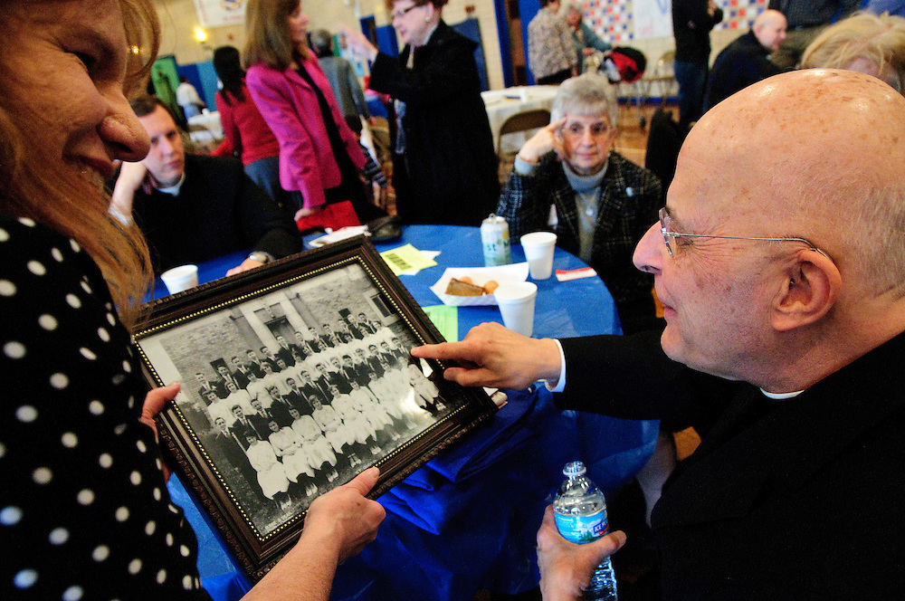Chicago Archbishop Francis Cardinal George (R) points himself out on the edge of his 1951 class photo during a reunion in the gymnasium of his alma matter, St. Pascal on the city's northwest side. George graduated with the class of 1951 and was ordained a priest there in 1963. March 4, 2012 l Brian J. Morowczynski~ViaPhotos..For use in a single edition of Catholic New World Publications, Archdiocese of Chicago. Further use and/or distribution may be negotiated separately. ..Contact ViaPhotos at 708-602-0449 or email brian@viaphotos.com.