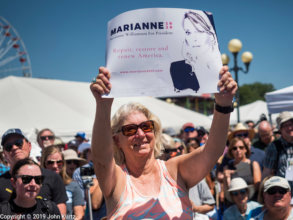 09 AUGUST 2019 - DES MOINES, IOWA: A woman holds up a sign for Marianne Williamson after Williamson spoke at the Iowa State Fair. Williamson, an author and activist, is running for the Democratic nomination for the US Presidency in 2020. She spoke at the Des Moines Register Political Soapbox at the Iowa State Fair Friday. Iowa hosts the the first election event of the presidential election cycle. The Iowa Caucuses will be on Feb. 3, 2020.         PHOTO BY JACK KURTZ