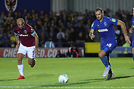 AFC Wimbledon striker James Hanson (18) battles for possession with West Ham United defender Paublo Zabalete (5) during the EFL Carabao Cup 2nd round match between AFC Wimbledon and West Ham United at the Cherry Red Records Stadium, Kingston, England on 28 August 2018.
