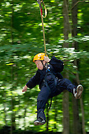 Town of Wallkill, New York - Devin Doty flies down a zip line while during a Ninja Warrior Day Camp trip to Ring Homestead Camp on July 8, 2014.