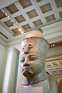 Red granite head from a colossal figure of a king. Eighteenth Dynasty, about 1390 BC. From Thebes, Temple of Mut