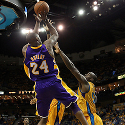 April 22, 2011; New Orleans, LA, USA; Los Angeles Lakers shooting guard Kobe Bryant (24) shoots over New Orleans Hornets center Emeka Okafor (50) during the fourth quarter in game three of the first round of the 2011 NBA playoffs at the New Orleans Arena. The Lakers defeated the Hornets 100-86.   Mandatory Credit: Derick E. Hingle