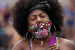 Verretta Strickland of St. Paul, Minn., became emotional as she and others gather in the street at the site of George Floyd's death to listen to audio from Floyd's memorial service on Thursday, June 4, 2020, in Minneapolis. Photo by Anthony Souffle/Minneapolis Star Tribune/TNS/ABACAPRESS.COM